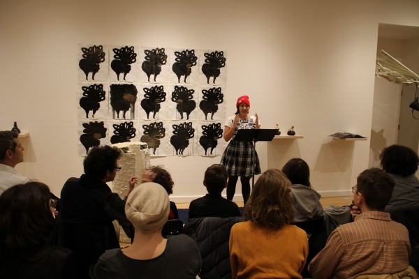 "Trisha Low reads from The Purge, Kenning Editions 2014. Art work by Shoshanna Weinberger, ""Posthumous Pin-Ups,"" 2014. 15 ink/collage drawings, 21"" x 16.5"" ea. Photo by Caroline Picard."
