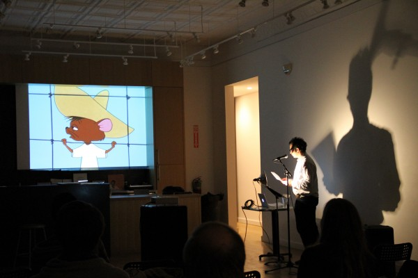 """Daniel Borzutzky performs """"El Gato Pussycat Proteja Your Gringo Cheese,"""" a neo-benshi piece for the first Annual Poets Theater, co-curated by Patrick Durgin (Kenning Editions) and Devin King (The Green Lantern Press). Photo by: Amelia Charter."""