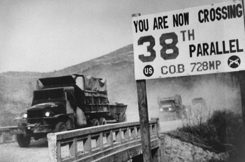 UN forces' transport vehicles recrossing 38th Parallel as they withdraw from Pyongyang, North Korean capital, during Korean War.  (Photo by Time Life Pictures/National Archives/The LIFE Picture Collection/Getty Images)