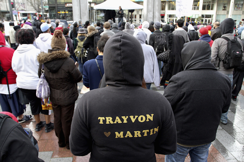 Vicky Vorachack (C) , 24, of Seattle, decorated her hoodie which reads Trayvon Martin, as she attends the Seattle Unite 1000 Hoodies rally for Trayvon Martin at Westlake Park in Seattle, Washington, March 28, 2012. Neighborhood watch volunteer George Zimmerman shot and killed an unarmed 17-year-old Trayvon Martin on February 26, 2012 in Sanford, Florida. REUTERS/Marcus Donner (UNITED STATES - Tags: CRIME LAW SOCIETY)