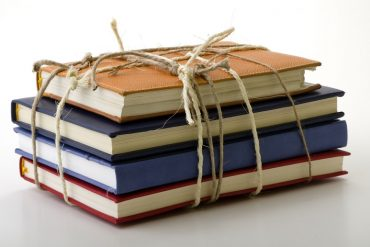 Stack of books bound by twine